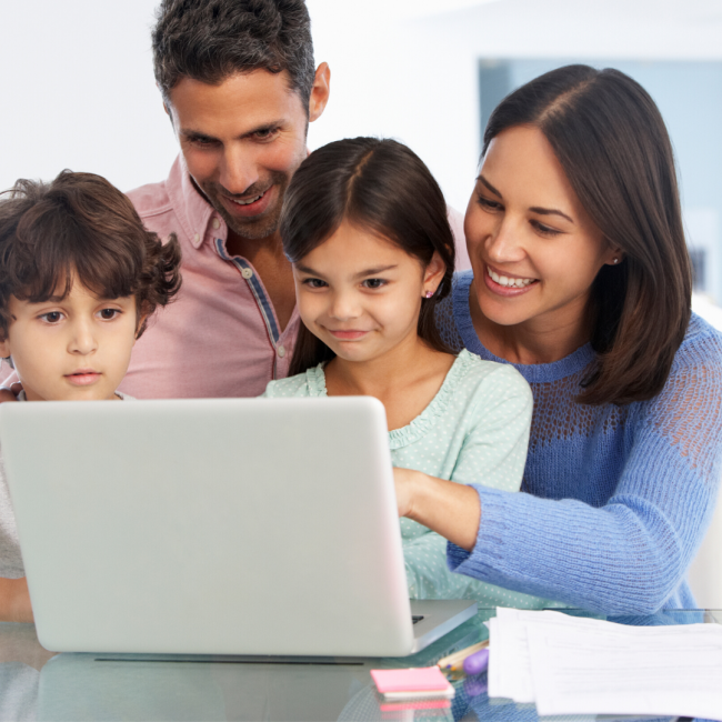 Family on computer in home
